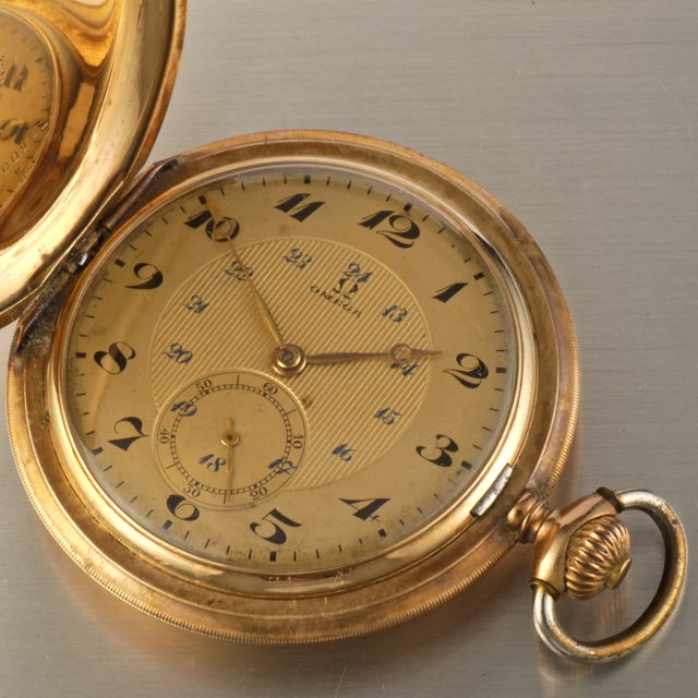 Omega gold hunter pocket watch